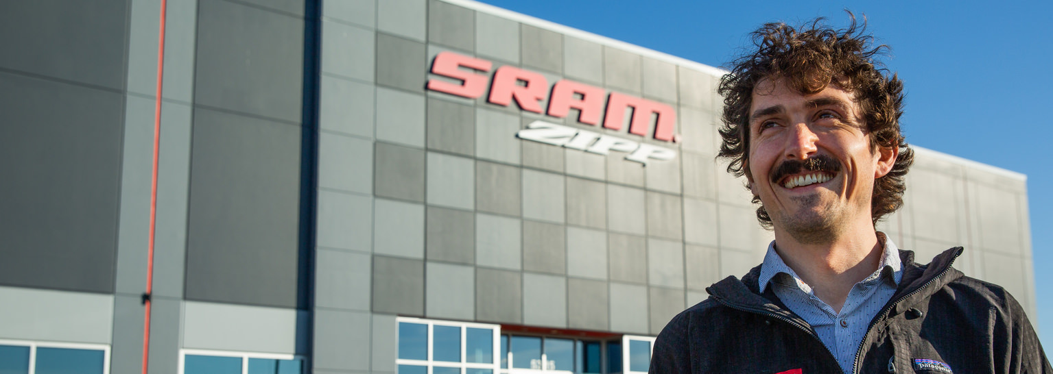 Photo of David in front of the SRAM/Zipp signage/building